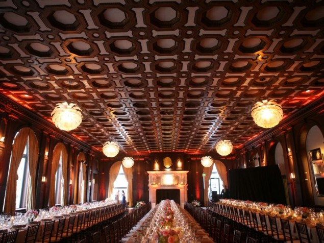 The coffered mahogany ceiling and pinecone lighting provide a distinctive ambiance