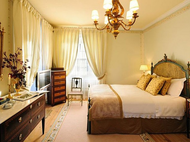 The finely furnished, Portugese-inspired guest bedroom