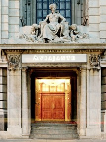 The rich detailing of the historic building entrance retains its importance as the hotel's entrance