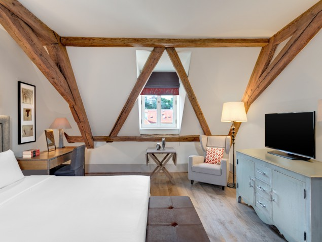 Augustine shows off its proud history - and its exposed beams - in this Deluxe Premium Room