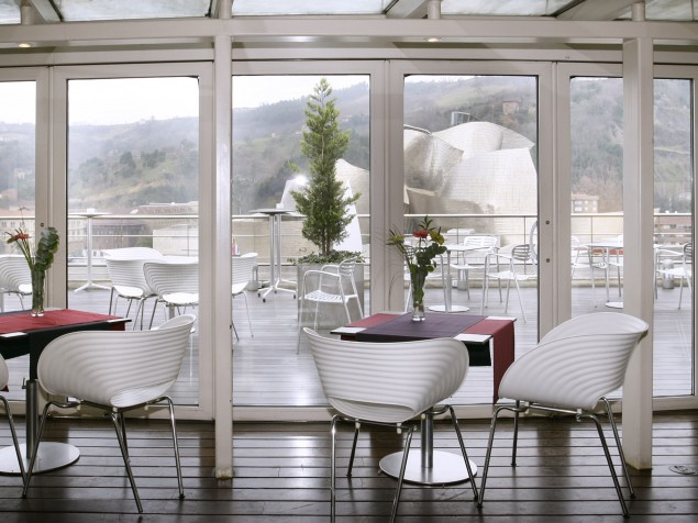 Restaurant Doma, featuring floor-to-ceiling glass and views to its famous neighbor