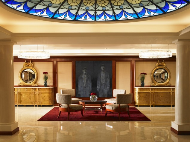 The lobby features contemporary furnishings, modern art, and a museum of its history