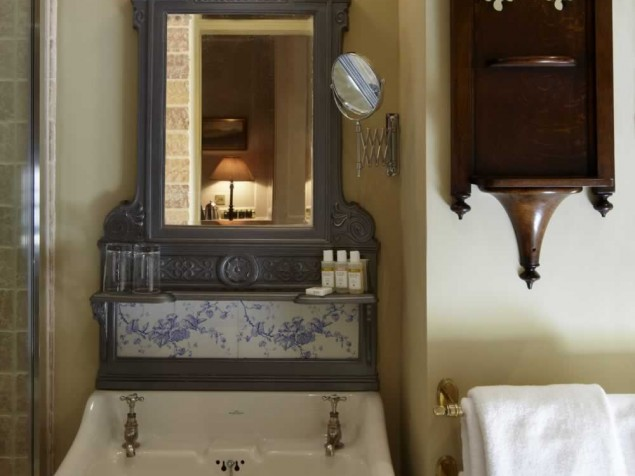 The fixtures and accents in the bathrooms speak to the creativity of the designers