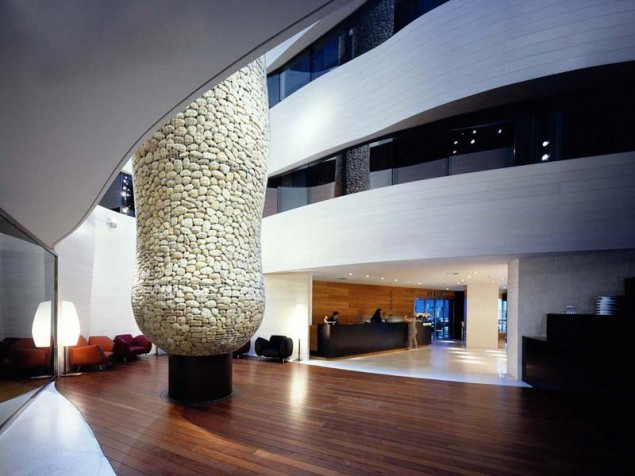 "The reception area draws you to the Atrium, centered around this sculptural ""tree"""