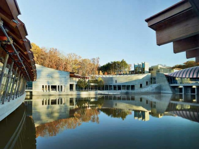 The peaceful setting of Crystal Bridges is enhanced by the reflections of the surrounding ponds