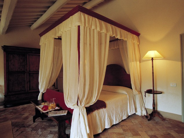 Nothing exudes romance more than this beautifully draped four-poster bed