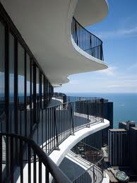 The irregular shaped balconies create the appearance of undulating  walls