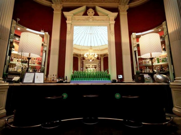 At days end, have a well-deserved cocktail in the historic Bollinger Bar at Palm Court