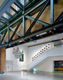 Exposed steel, glass roof and and brick walls provide a unique gallery atmosphere