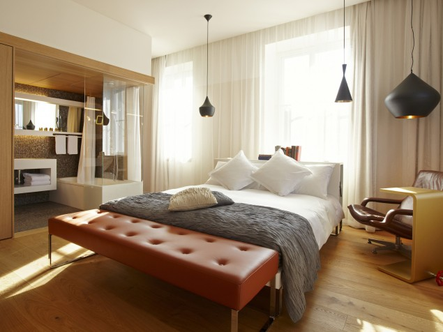 Guest rooms feature high ceilings, great big windows, and classic modern furnishings