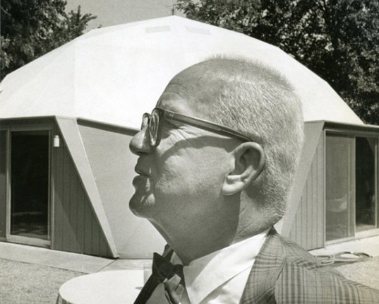 Bucky Fuller, standing with pride in front of his historic yet intimate dome.