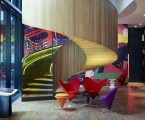 The new urban lifestyle is alive and well at CitizenM London Bankside, with this winding stair revolving, literally, around colorful modern furniture