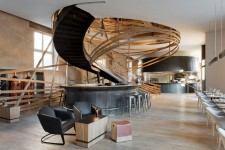"The ""vortex"" staircase of wood strips at Brasserie Les Haras, by Jouin Manku Studio"