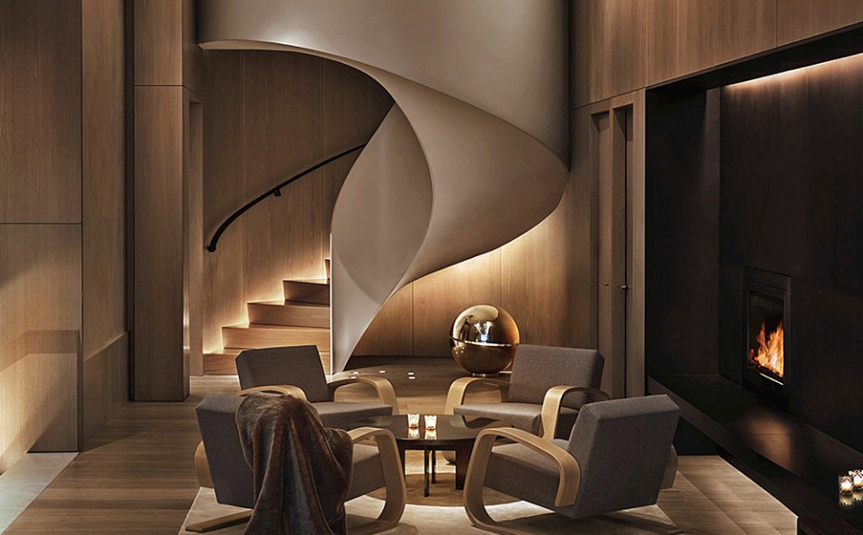 This elegant winding staircase at The New York EDITION resembles to us, a flame, offering a both artistic and soothing compliment to the fireplace
