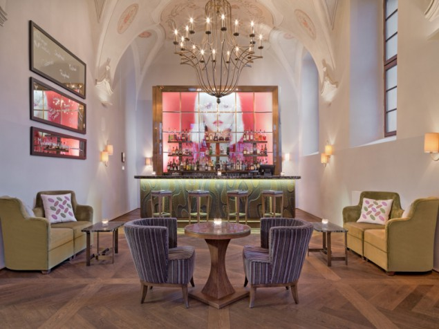 The architectural centerpiece is the Refectory Bar, with its historic vaulted, frescoed ceilings